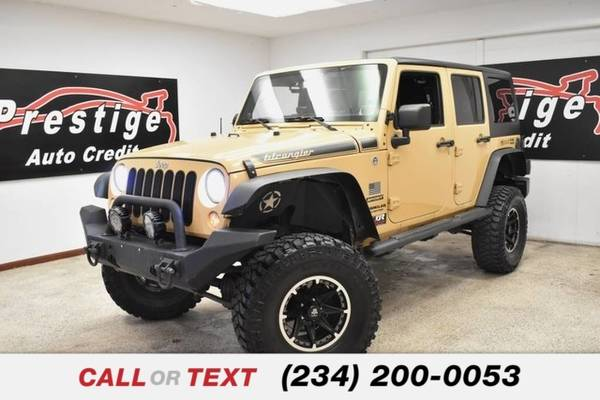 Photo 2014 Jeep Wrangler Unlimited Sport - $25,451 (1501 Vernon Odom Blvd Akron, OH 44320)