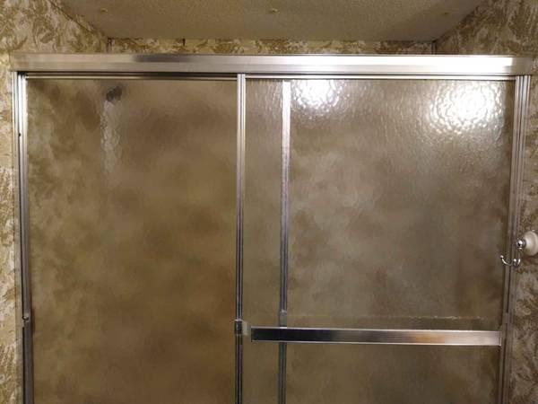 Photo sliding glass doors for bathtub - $90 (Meadville)