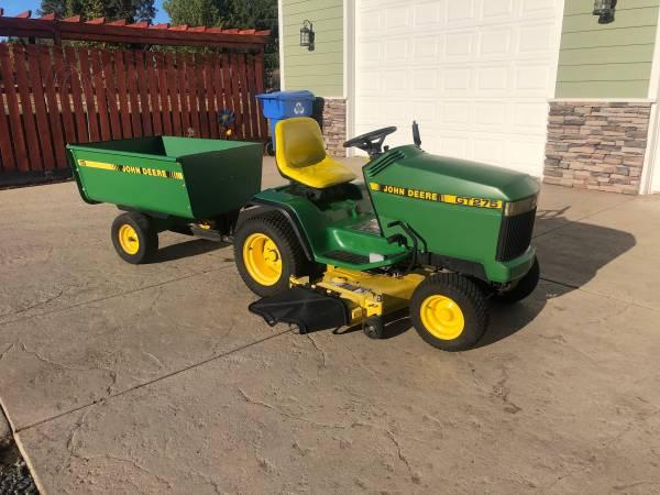 Photo John Deere GT275 Garden Tractor with trailer - $1,800