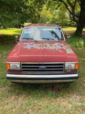 Photo 1990 Ford F-150 xlt lariant - $8,000 (Arlington)