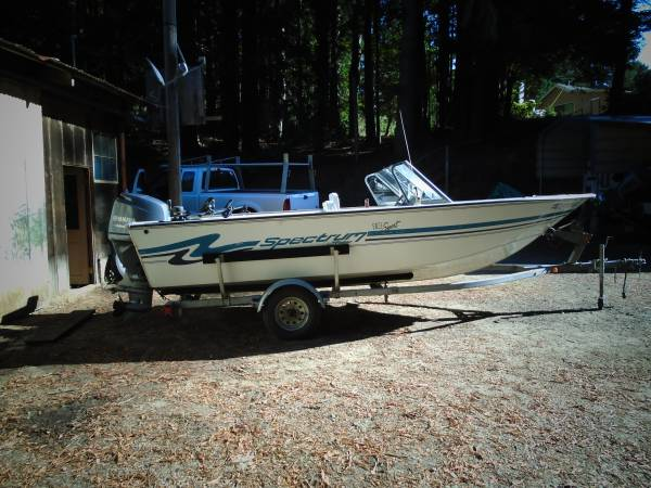 Photo 1997 Spectrum with 2016 yamaha 90hp four stroke 50 hours - $8700