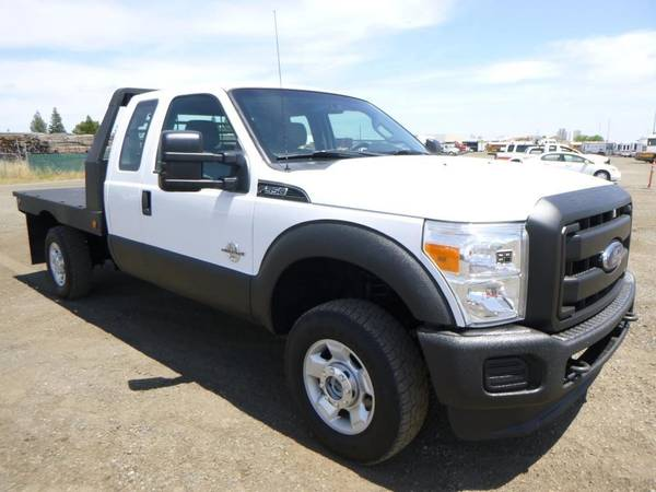 Photo 2013 Ford F350 Extra Cab Flatbed Truck