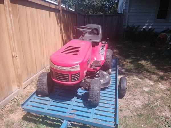Photo Murray riding lawn mower 18hp 42in cut - $250