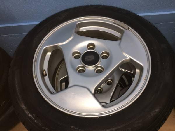 Photo Mud  snow tires , Saab wheels - $80 (missoula)