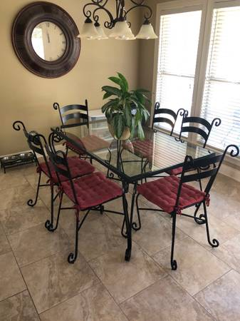 Photo Pier 1 Glass top black Metal dining table with 6 chairs - $500 (Mobile)