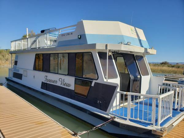 Photo 3 Buoys 40 foot houseboat in a slip WITH TRAILER - $30000 (Lake Havasu City)