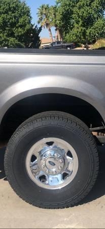 Photo Ford F250 F350 parts, 4 wheels, 2 running boards - $250 (Kingman AZ)