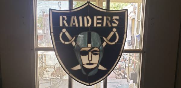 Photo Raiders stained glass sun catcher39s - $75