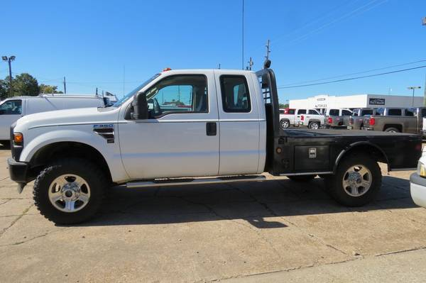 Photo 2008 Ford F350 XL Extended Cab Diesel Flatbed 4x4 - $9700 (Monroe, LA)