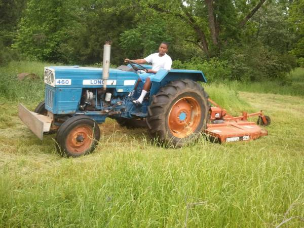 Photo Diesel Tractor for sale  with implements - $4,000 (Ruston)