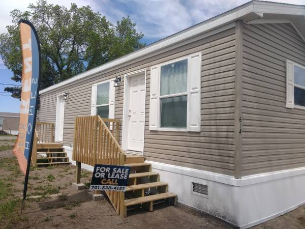 Photo HOME FOR SALE 2020 BRAND NEW HOME FOR SALE (Minot MHP North Star MHP)