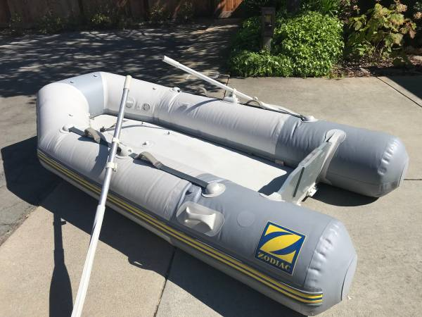 Photo 2005 Zodiac inflatable bottom boat with 3.5 hp Nissan outboard engine - $1700 (Monterey Bay Area)