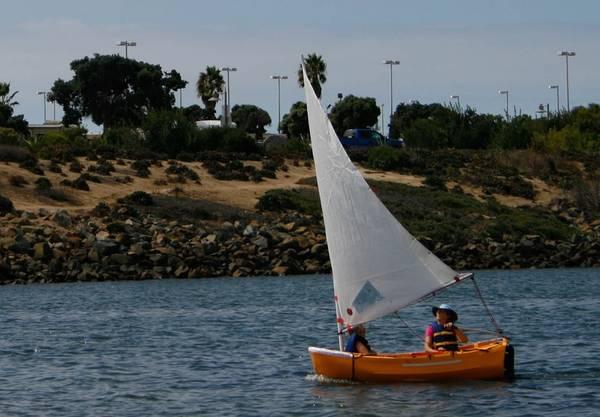 Photo Portland Pudgy dinghy  Honda 2.5 hp outboard - $5,000 (San Diego)