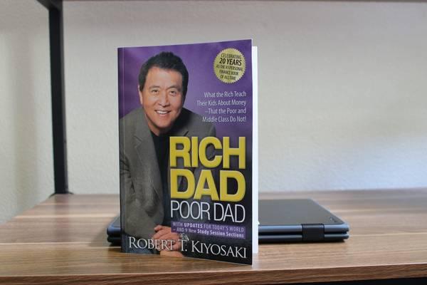 Photo Rich Dad Poor Dad by Robert T. Kiyosaki - $5 (Seaside, CA)