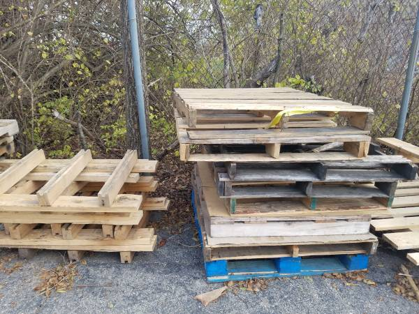 Photo Free wood skids  pallets  boards various sizes, stored on pavement (Dayton)