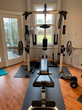 Photo SST Weight bench with lat, row, peck, leg and curl - $400 (N. Myrtle Beach)
