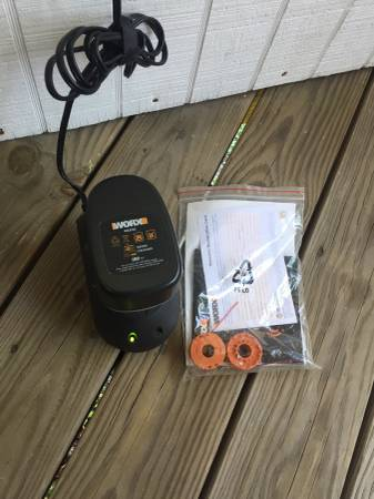 Photo Worx 18v battery, charger, two weed eater cartridges and owners manual - $10 (Calabash)