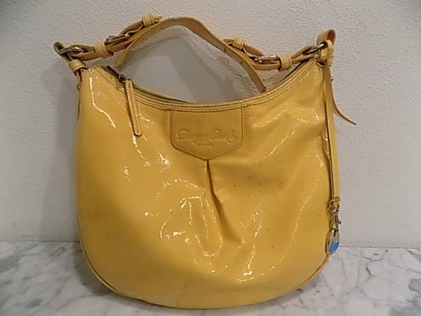 Photo Yellow Dooney and Bourke purse - $25 (SUNSET BEACH)