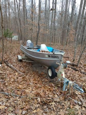Photo 14 ft solid aluminum boat with 16 horsepower Johnson seahorse motor - $1100 (Kingston Springs)