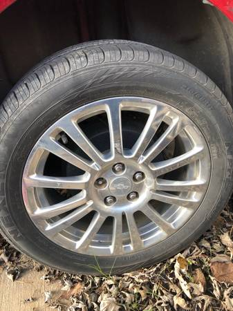 Photo set of 4 21555R17 tires With Chrome Wheels On Them For 2012-2015 Chevy Cruze - $650 (Antioch)
