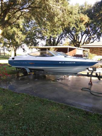 Photo Boat and 22 ft trailer. Boat Needs work. As is. 5.0 litre motor engine - $900 (White Castle)