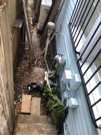 Photo Free hot tub motorpump to whomever removes this stuff (New Orleans)