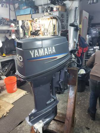 Photo 40 hp Yamaha Outboard motor engine electric start tiller handle - $2500 (I will ship worldwide)