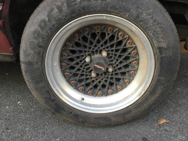 Photo Ford, jaguar 4 lug Epsilon rims and tires , tires are ok , very rare - $1,500 (Staten Island)