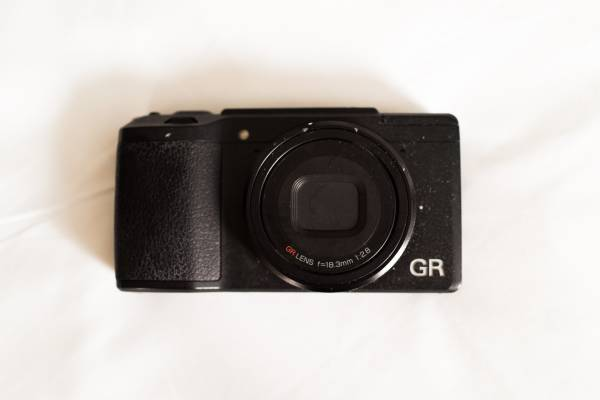 Photo Ricoh GR II 16.2MP  Shutter Count 002457  Extra battery included - $400