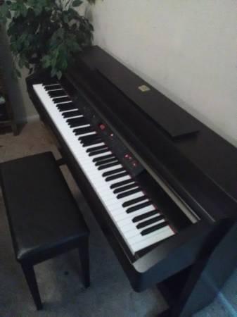 Photo Yamaha Clavinova Piano CLP 230 - $1,400 (Virginia Beach)