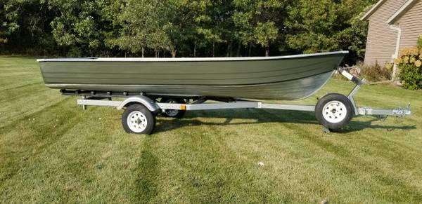 Photo 1639 Mirrocraft aluminum boat and trailer - $900 (Eau Claire)