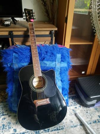 Photo First Act acoustic guitar with electric pickup - $150 (Eau Claire)