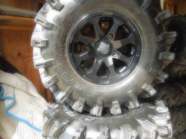 Photo atv tires  wheels - $700 (Hernando Ms.)