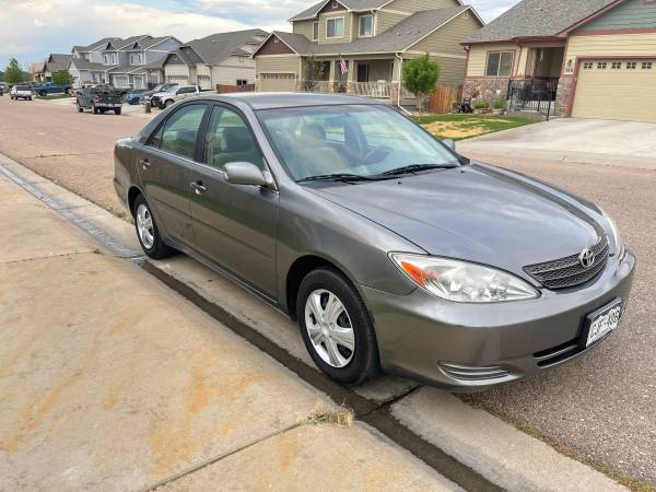 Photo 2003 toyota camry LE low miles with car fax - $4,400 (Evans)