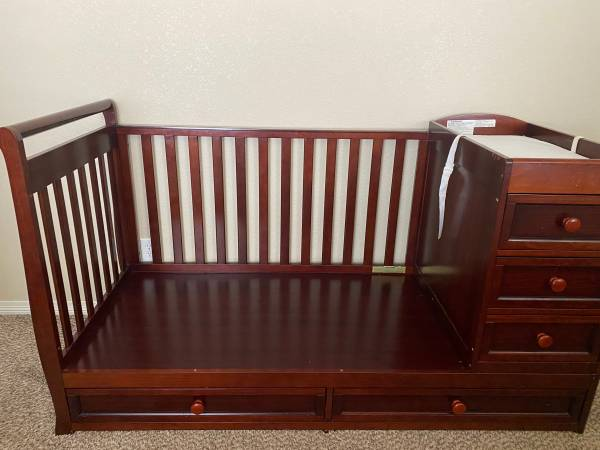 Photo Baby Crib with changing station and storage - $80 (Fort Collins)