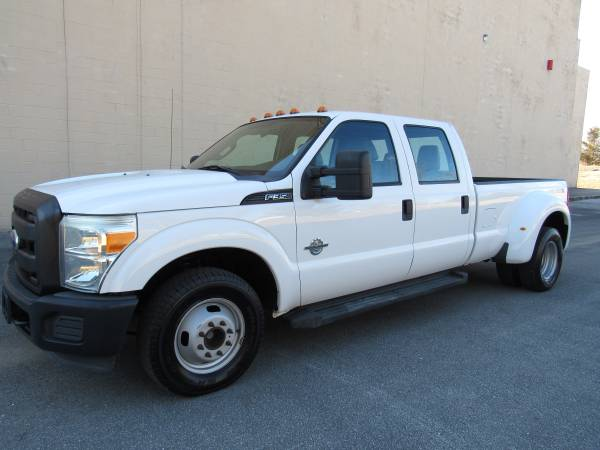 Photo 2011 FORD F350  CREW CAB  42K  DIESEL  DUALLY  LONG BED - $31,995 (NO DOC FEES)