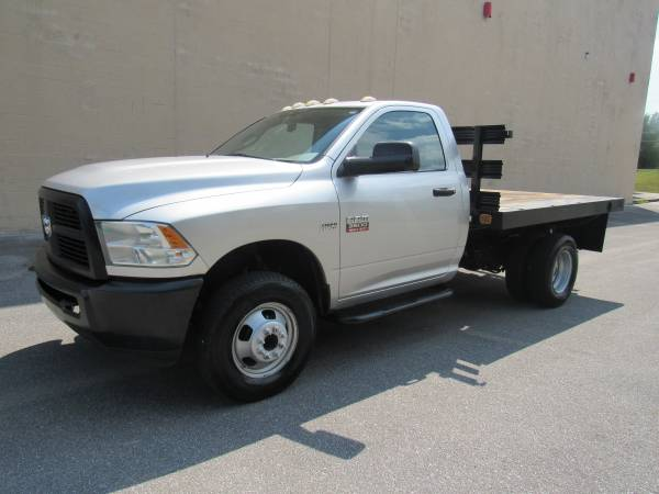 Photo 2012 RAM 3500 ST  38K MILES  FLAT BED  DUALLY  4X4  1 OWNER  - $29,995 (NO DOC FEES)
