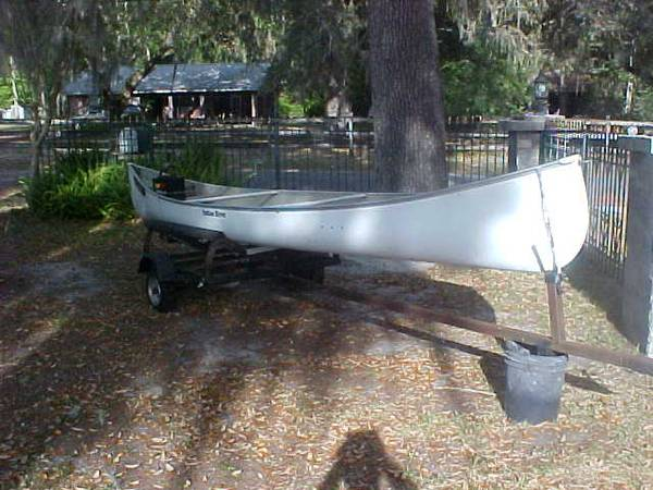 Photo 18 ft. 3 man Indian River canoe with trailer and electric motor motor - $395 (silver springs fl.)