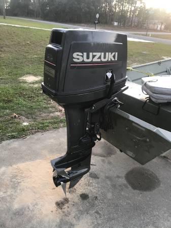 Photo Suzuki 25hp tiller outboard - $1250 (Dunnellon)
