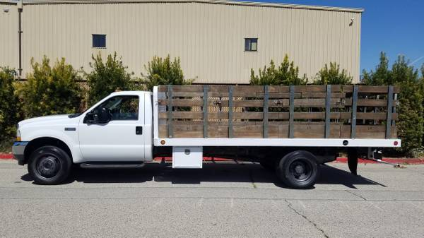 Photo FORD F550 DUALLY DIESEL 16FT STAKEBED FLATBED WORK TRUCK 93k MILES - $13,500 (MIDLAND)