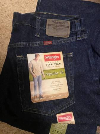 Photo 8 pair Wrangler 37 x 30 Dark blue Jeans regular fit - $64 (Sugar City)