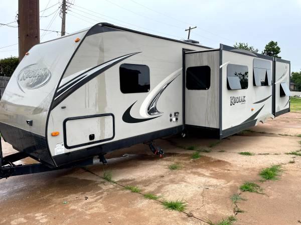 Photo 2013 Dutchman, Kodiak 300BHSL bumper pull with 3 slides, 30 ft - $12,900 (Oklahoma City)