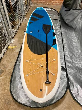 Photo 11 Radar Standup Paddleboard with paddle  Yakima Roof Rack - $885 (Omaha, NE (downtown))