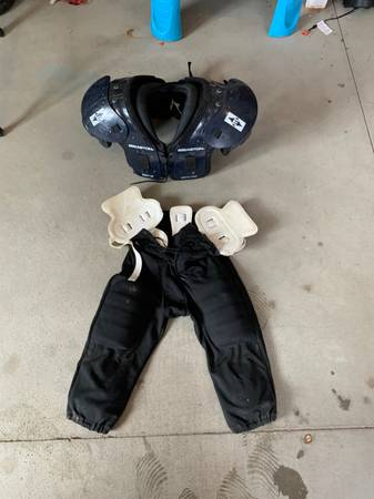 Photo Easton football shoulder pads and football - $50