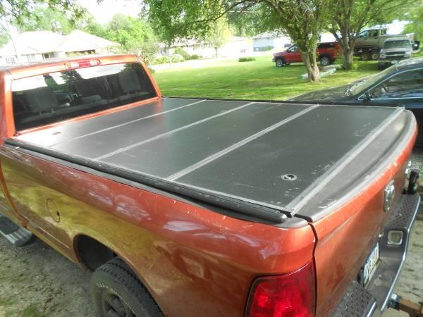 Photo Factory Dodge Ram 839 fold up tonneau cover - $200 (Council BluffsOmaha)