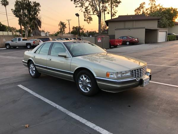 Photo 1997 Cadillac SLS V8 Super low miles - $2800 (Santa Ana)