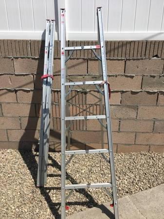 Photo 639 aluminum folding ladder - $75 (Huntington Beach)
