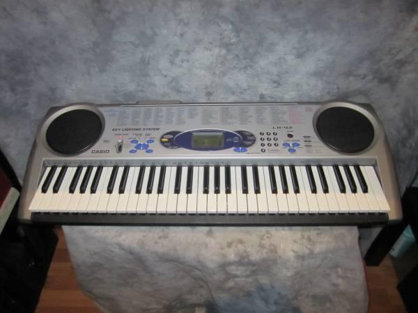 Photo Casio LK-43 Lighted Musical Keyboard Digital Piano with MIDI - $60 (Orange)