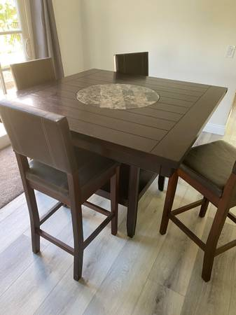 Photo Dining table - (4) chairs included - $550 (Orange)