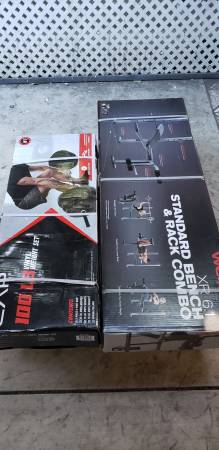 Photo New in box 100LB weight set with bench press combo includes barbell and clips - $250 (Orange)